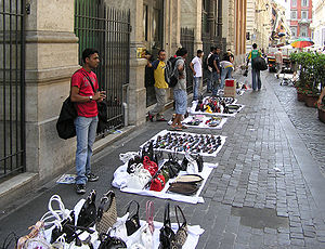 Hawker (trade) - Street hawkers selling bags and sunglasses in central Rome, Italy