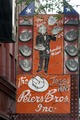 """Street sign for Peters Brothers """"Texas Hat"""" shop in Fort Worth, Texas LCCN2014633673.tif"""