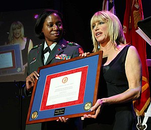 Suzanne Somers - Somers receiving patriotic civilian service award for past USO tour performances after performing The Blonde in the Thunderbird for members of the US military and their families.