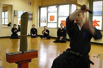 Tameshigiri - Tameshigiri using a goza target on a stand (2006) Ren Kuroda demonstrates Shofu at the Mugairyu Meishi-ha dojo in Tokyo, Japan