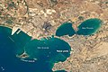 Taranto & harbor from ISS 2017.JPG