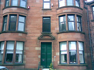 Architecture in Glasgow - Typical red sandstone Glasgow south side tenement (Shawlands).