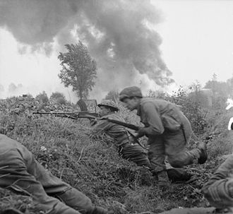 Derbyshire Yeomanry - Troops of the 2nd Derbyshire Yeomanry take cover in a ditch during an attack on St Michielsgestel, 24 October 1944.