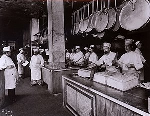 Workers in the kitchen at Delmonico's Restaura...