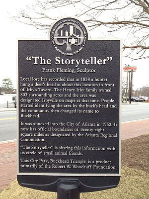 Buckhead Village - Descriptive plaque of The Storyteller