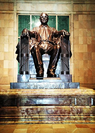 "Ambedkar Memorial Park - The bronze statue of Ambedkar in Ambedkar Memorial; the base is inscribed ""My struggle of life is my only message."" The Ambedkar statue was modeled on the sculpture of Abraham Lincoln at the Lincoln Memorial in Washington, D.C.."