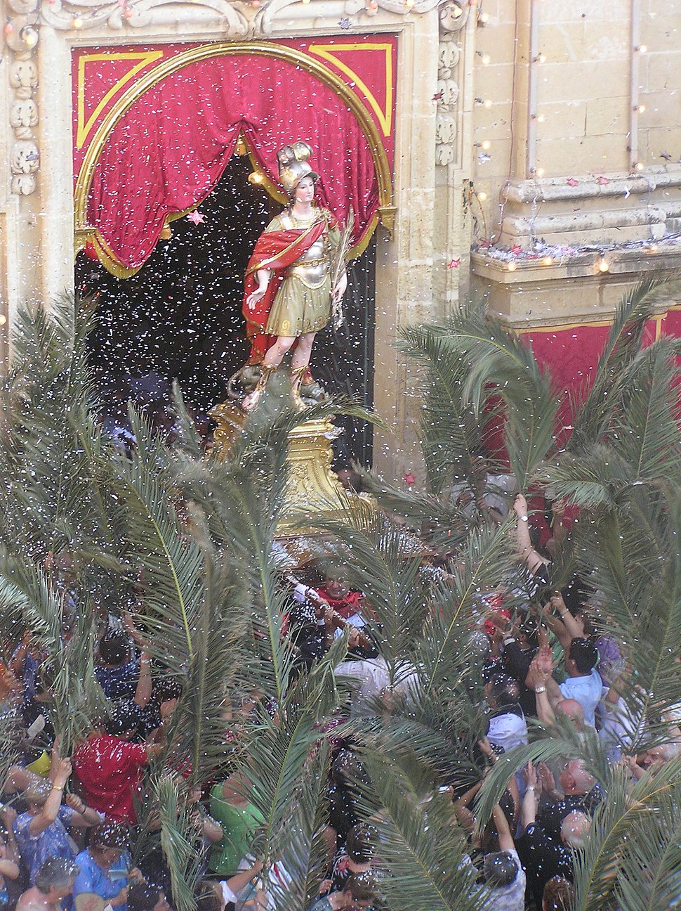 The statue of St. George issuing from the Basilica on the third Sunday of July
