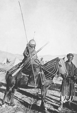 Tibetan Army - Before the reforms of the 13th Dalai Lama, Tibetan warfare was still stuck in the middle ages. This armoured horseman, photgraphed in 1903/1904, wields a spear, sword and matchlock musket.