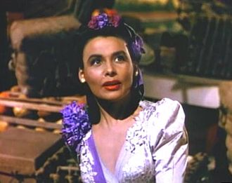 "Lena Horne - Horne as Julie LaVerne in a mini-production of Show Boat in Till the Clouds Roll By (1946), singing ""Can't Help Lovin' Dat Man""."