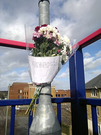 "Roadside memorial - A tribute at a North London railway station. The message reads: ""You collapsed one month ago here at the station died 13 days later. RIP Tracey your son is doing well. X Love and miss you loads"""