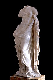 Aphrodite Ourania, draped rather than nude, and with one of her bare feet resting on a tortoise (Musée du Louvre)