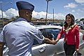U.S. Air Force Chief Master Sgt. Leslie Bramlett, left, the command chief master sergeant of the 15th Wing, greets U.S. Rep 130329-F-MQ656-001.jpg
