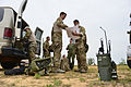 U.S. Air Force joint terminal attack controllers read maps prior to calling in air support at Hurlburt Field, Fla., April 24, 2013, during exercise Emerald Warrior 2013 130424-F-IO684-0025.jpg