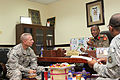 U.S. Army Command Sgt. Maj. Ronnie R. Kelley, left, the senior enlisted adviser of U.S. Army Central Coalition Forces Land Component Command, speaks to Col. Abdul Salem, the commandant of the Kuwait Ministry 140827-A-DO086-017.jpg