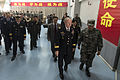 U.S. Army Gen. Martin E. Dempsey, center right, the chairman of the Joint Chiefs of Staff, departs from a meeting with People's Liberation Army (PLA) cadets at a PLA Aviation Corps academy near Beijing April 24 130424-D-VO565-047.jpg