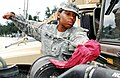 U.S. Army Pfc. Dehzcha Edwards, with Bravo Company, 136th Engineering Support Battalion, Louisiana Army National Guard, checks the oil level of a Humvee in preparation for Hurricane Isaac operations in Carville 120828-A-E0763-082.jpg