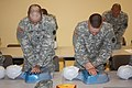 U.S. Army Spc. Michael Marek, left, and Cadet Timothy Hard conduct chest compressions on a practice mannequin June 8, 2013, at the Camp Sherman Readiness Center in Chillicothe, Ohio 130608-A-EU423-702.jpg