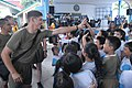 U.S. Marine Corps Cpl. Joe Abadiotakis, left, assigned to Bravo Company, 1st Battalion, 8th Marine Regiment, high-fives a student at Santa Rita Elementary School in Subic Bay, Philippines, June 27, 2014, during 140627-N-PK322-009.jpg