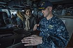 U.S. Navy Cmdr. Jonathan Schmitz, right, the commanding officer of the guided missile destroyer USS Fitzgerald (DDG 62), explains the ship's navigation systems to a member of the Council on Foreign 140310-N-ZS026-095.jpg