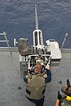 U.S. Navy Fire Control Technician 2nd Class John Dees fires a 25 mm machine gun during live-fire exercises aboard the submarine tender USS Emory S. Land (AS 39) in the Pacific Ocean June 6, 2013 130606-N-GL207-004.jpg