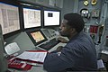 U.S. Navy Gas Turbine System Technician (Mechanical) 2nd Class Quazavier Henderson monitors the engineering systems during a basic engineering casualty control exercise Jan. 15, 2014, in the central control 140115-N-UD469-377.jpg