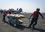 U.S. Navy Sailors move ordnance aboard USS Nimitz in the Arabian Gulf. (36009631052).jpg