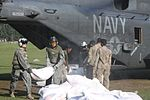 U.S. Navy sailors with Helicopter Mine Countermeasures Squadron 15, Detachment 2 help Pakistani soldiers offload relief supplies from a U.S. Navy MH-53E Sea Dragon helicopter during humanitarian relief efforts 100821-M-ZG155-603.jpg