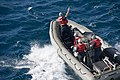 U.S. Sailors assigned to the guided missile destroyer USS Momsen (DDG 92) travel in a rigid-hull inflatable boat in the Coral Sea July 24, 2013, after departing from the amphibious dock landing ship USS 130724-N-KL846-069.jpg
