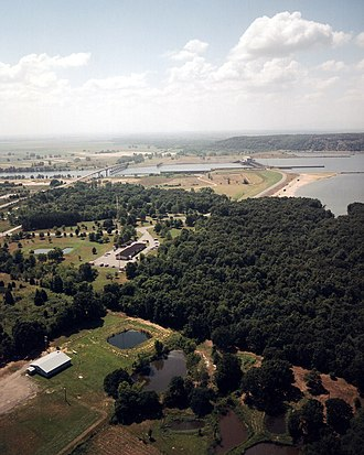 Robert S. Kerr - An aerial view of the Robert S. Kerr Lock and Dam that forms Robert S. Kerr Reservoir on the Arkansas River in Oklahoma. The Kerr-McClellan Arkansas River Navigation System is co-named to honor Kerr for his role in obtaining funding and legislation to build the system.