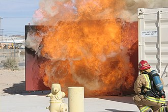 Backdraft - A firefighter demonstrates the behavior of a backdraft during live-fire training