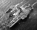 USS Graffias (AF-29) replenishes USS Coral Sea (CVA-43) and USS Marshall (DD-676) in November 1963.jpg