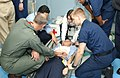 US Navy 021212-N-9563N-502 medical staff conduct medical assistance training on simulated injuries during a mass casualty drill.jpg