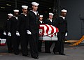 US Navy 040214-N-4757S-056 Pallbearers carry the casket for a retired U.S. Navy Commander through the hanger bay aboard USS Harry S. Truman (CVN 75).jpg