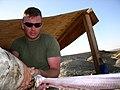 US Navy 040414-N-1464F-005 Lance Cpl. Mitchell K. Bahzad skins a snake for food while attending Desert Environmental Survival Training (DEST).jpg