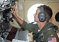 US Navy 040818-N-2559S-013 Patrol Squadron Three Zero (VP-30) navigator, Ensign Jeremy M. Hansler, checks the aircrafts position during a cross-country flight in a P-3C Orion.jpg