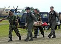 US Navy 050103-N-9951E-171 Lt. Lisa Peterson, of Derwood, Md., center, Lt. Mark Banks, of Savannah, Ga., and two Indonesian Army personnel carry a patient on a stretcher flown-in by a U.S. Navy helicopter.jpg