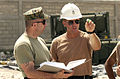 US Navy 050114-N-4936C-005 Chief Equipment Operator Mark Thomas (right) speaks with Master Sgt. Thomas Evans about preparations move equipment from Camp Unity to the amphibious assault ship USS Nassau (LHA 4).jpg