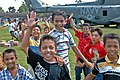 US Navy 050123-N-9885M-136 Indonesian children gather around a MH-53E Sea Dragon helicopter as air crewmen offload relief supplies in Lamno, Indonesia.jpg