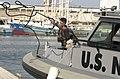 US Navy 050501-N-8500S-058 Chief Hospital Corpsman Karen Reyes assigned to Naval Coastal Warfare Group One (NCWGRU-1), Squadron 33, Inshore Boat Unit One Six (IBU-16) prepares to tie off the 34-foot Seaark Marine Patrol Boat.jpg