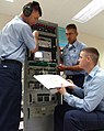 US Navy 050610-N-9246G-003 Cryptologic Technician Maintenance 2nd Class Christopher Gora assists students with troubleshooting an electronics suite.jpg