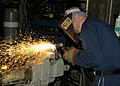 US Navy 050620-N-7869M-029 Hull Technician 1st Class Donald H. Stewart creates blank flanges for use during emergency repairs.jpg