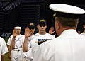 US Navy 050928-N-7163S-002 Members assigned to the Delayed Entry Program takes the Navy's oath of enlistment at the Minnesota Twins and Kansas City Royals Major League Baseball game.jpg