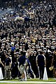 US Navy 051015-N-4790M-004 U.S. Naval Academy Midshipman Cheerleader Captain Kristin Strizki flys through the air in front of the Brigade of Midshipmen during the school's football game against Kent State University.jpg