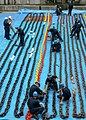 US Navy 060616-N-4953E-004 Boatswain's Mates paint the anchor chains aboard the guided-missile destroyer USS Stethem (DDG 63), while the ship is in the dry dock.jpg