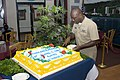 US Navy 070207-N-4856G-009 Chief Quartermaster James Watkins cuts himself a slice of the Ney Award cake in honor of the Edward F. Ney Award won by Naval Station Pearl Harbor's Silver Dolphin Bistro.jpg