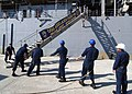 US Navy 070430-N-0780F-003 Sailors aboard Whidbey Island-class dock landing ship USS Ashland (LSD 48) move their starboard accommodation ladder into place as they arrive for a routine port visit.jpg