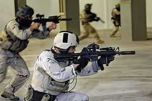 Close Quarters Battle Receiver - Navy SEALs with suppressors.