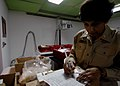 US Navy 070826-N-6278K-076 Cmdr. Nita Sood, a U.S. Public Health Service pharmacist attached to the Military Sealift Command hospital ship USNS Comfort (T-AH 20), fills out a prescription.jpg