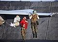 US Navy 070905-N-6346S-921 Aviation Machinist's Mate 2nd Class Charles Baker of Meshoppen, Pa., lifts himself off the flight deck of the nuclear powered aircraft carrier USS Enterprise (CVN 65) during final checks of an F-A-18C.jpg