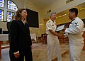 US Navy 071005-N-4399G-068 Rear Adm. James D. Kelly, commander of U.S. Naval Forces Japan, congratulates Culinary Specialist 3rd Class Jamie Manzon, assigned to USS Blue Ridge (LCC 19), as he presents him with a certificate of.jpg